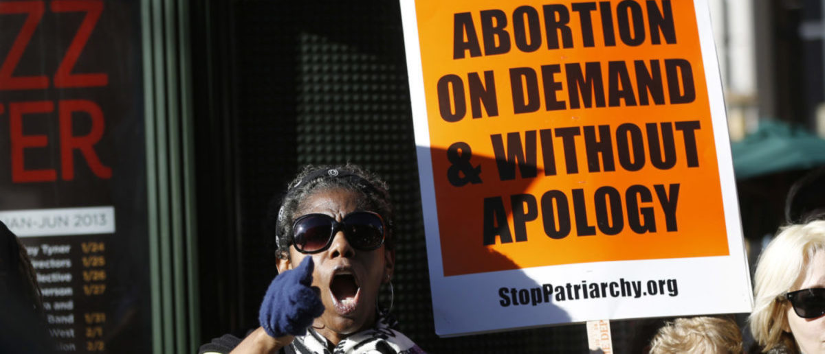A pro-choice demonstrator shouts during a counter demonstration at the Ninth Annual Walk for Life West Coast in San Francisco, California, January 26, 2013. Hundreds of pro-life demonstrators marched in San Francisco to mark the 40th anniversary of Roe v. Wade U.S. Supreme Court decision legalizing abortion. REUTERS/Stephen Lam   Abortion Bill Passes In Landslide Vote
