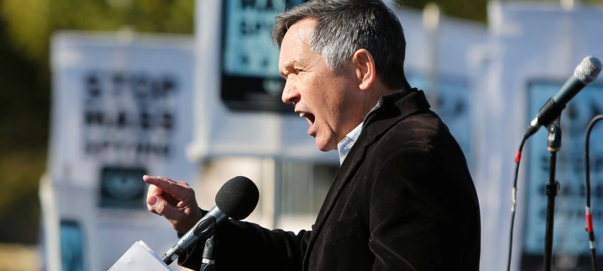 """Former U.S. Representative Dennis Kucinich (D-OH) addresses the """"Stop Watching Us: A Rally Against Mass Surveillance"""" near the U.S. Capitol in Washington, October 26, 2013. REUTERS/Jonathan Ernst"""