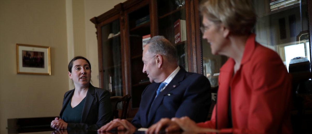Leandra English (L), deputy director of the Consumer Financial Protection Bureau (CFPB) meets with Senate Democratic Leader Chuck Schumer (D-NY) and Senator Elizabeth Warren (D-MA) in Capitol Hill, Washington, D.C., November 27, 2017. REUTERS/Carlos Barria - RC1D1FEBB070
