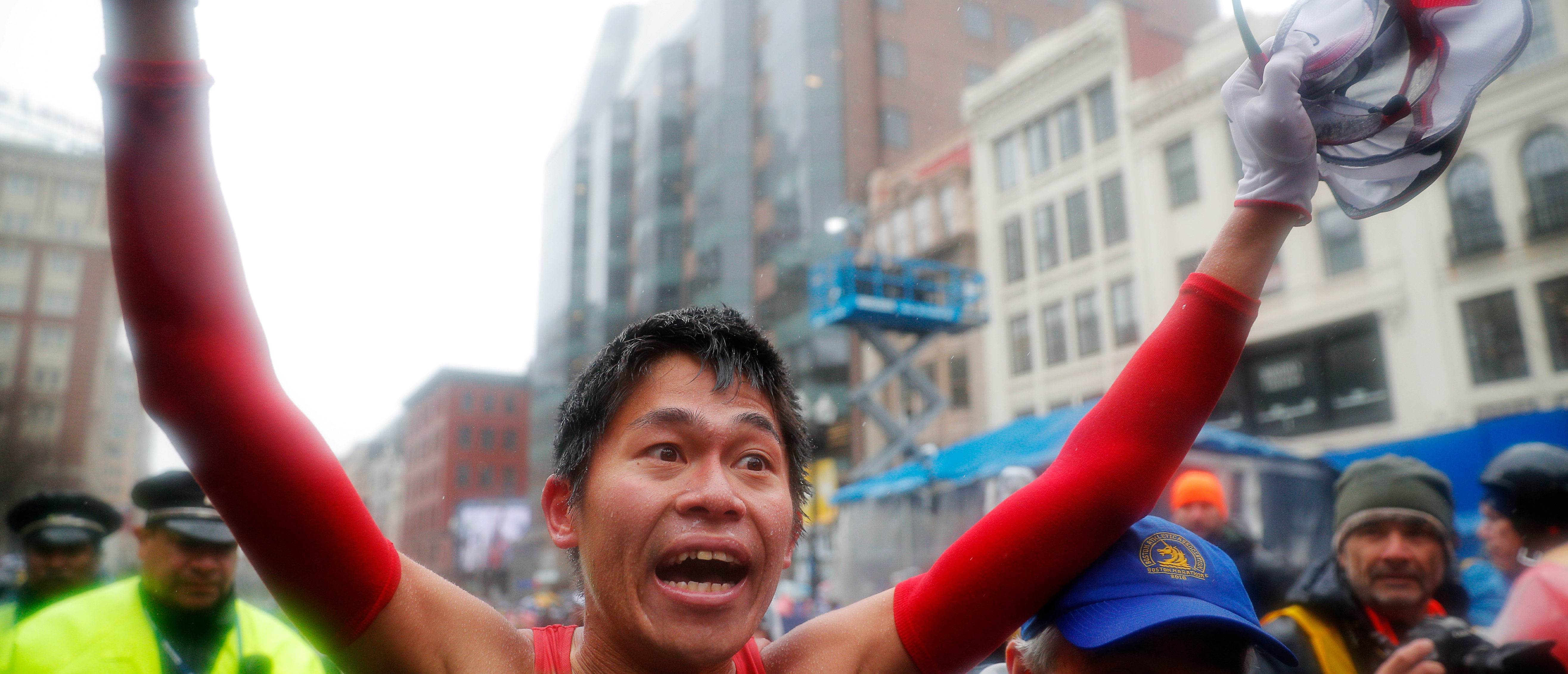 Yuki Kawauchi of Japan celebrates after winning the men's division of the 122nd Boston Marathon April 16, 2018. REUTERS/Brian Snyder