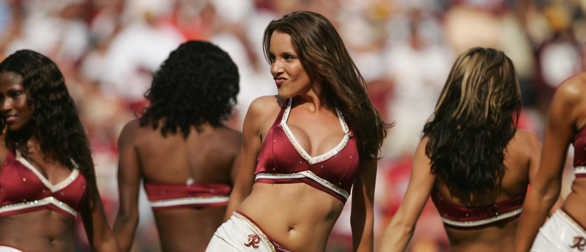 LANDOVER, MD - SEPTEMBER 12: A cheerleader of the Washington Redskins performs on the field during the game against the Tampa Bay Buccaneers at FedEx Field on September 12, 2004 in Landover, Maryland. Redskins defeated the Buccaneers 16-10. (Photo by Doug Pensinger/Getty Images)