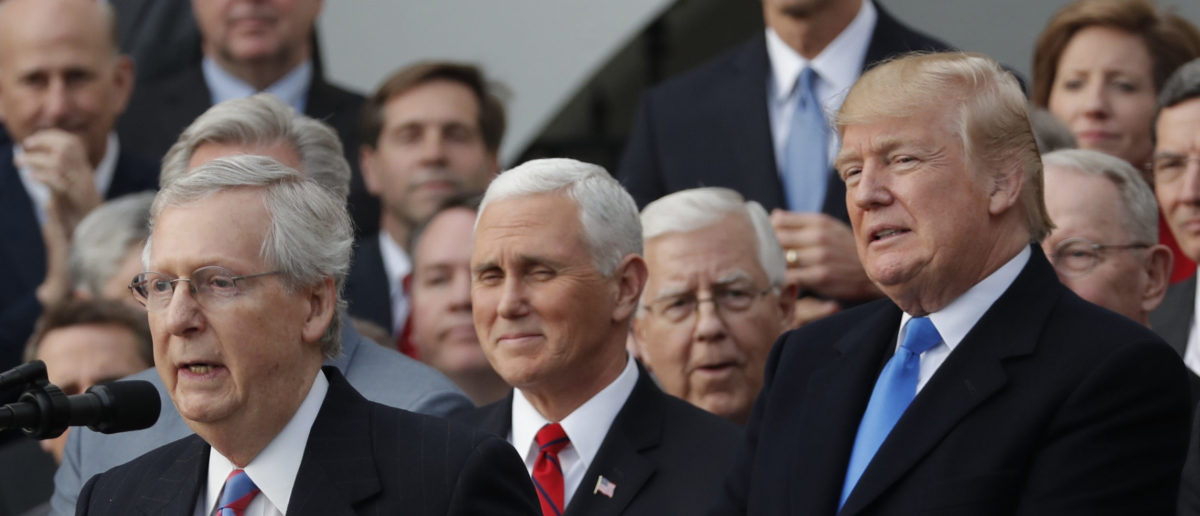 U.S. Senate Majority Leader Mitch McConnell (R-KY) speaks next to U.S. President Donald Trump, Vice President Mike Pence and Congressional Republicans as they celebrate passage of sweeping tax overhaul legislation on the South Lawn of the White House in Washington, U.S., December 20, 2017. REUTERS/Carlos Barria