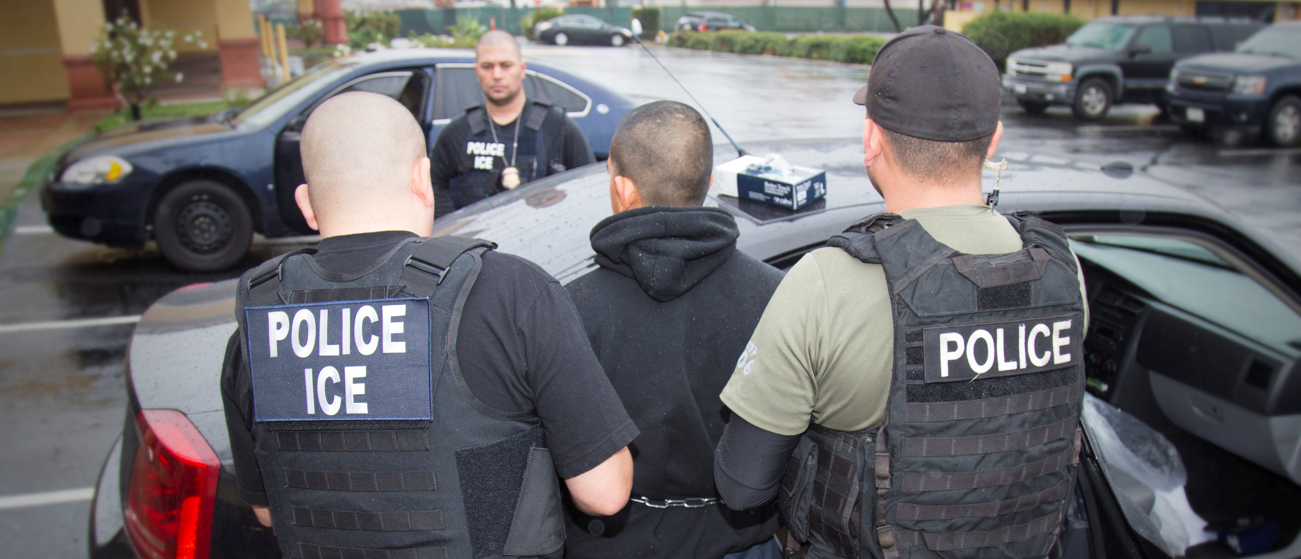 U.S. Immigration and Customs Enforcement (ICE) officers detain a suspect as they conduct a targeted enforcement operation in Los Angeles, California, U.S. on February 7, 2017. Picture taken on February 7, 2017. Courtesy Charles Reed/U.S. Immigration and Customs Enforcement via REUTERS ATTENTION EDITORS - THIS IMAGE WAS PROVIDED BY A THIRD PARTY. EDITORIAL USE ONLY. - RC19C99BF310