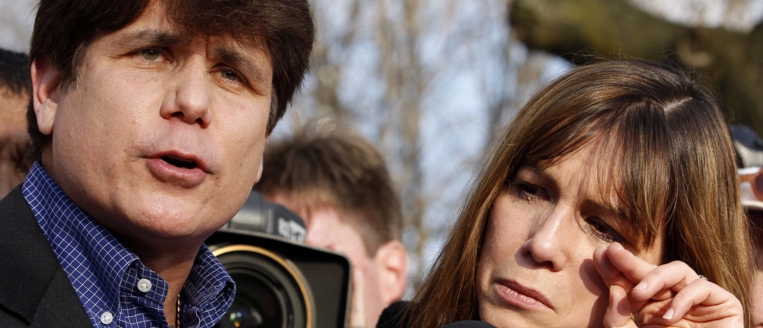 Former Governor of Illinois Rod Blagojevich, with his wife Patti, makes a statement to reporters outside his Chicago home one day before reporting to federal prison in Colorado to serve a 14-year sentence for corruption, March 14, 2012. REUTERS/Jeff Haynes