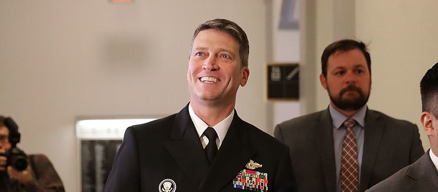 Physician to the President U.S. Navy Rear Admiral Ronny Jackson waves to journalists as he heads into a meeting with Senate Veterans Affairs Committee Chairman Johnny Isakson (R-GA) in the Russell Senate Office Building on Capitol Hill April 16, 2018 in Washington, DC. President Donald Trump nominated Jackson, his personal doctor at the White House, to be the new Secretary of the Department of Veterans Affairs after Trump fired David Shulkin on March 28. (Photo by Chip Somodevilla/Getty Images)