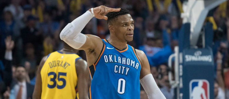 OKLAHOMA CITY, OK - APRIL 3: Russell Westbrook #0 of the Oklahoma City Thunder reacts after scoring three points against the Golden State Warriors during the second half of a NBA  game at the Chesapeake Energy Arena on April 3, 2018 in Oklahoma City, Oklahoma. The Warriors won 111-107. NOTE TO USER: User expressly acknowledges and agrees that, by downloading and or using this photograph, User is consenting to the terms and conditions of the Getty Images License Agreement. (Photo by J Pat Carter/Getty Images)