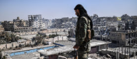 """SDF fighters flushed jihadist holdouts from Raqa's main hospital and municipal stadium, wrapping up a more than four-month offensive against what used to be the inner sanctum of IS's self-proclaimed """"caliphate"""", which for three years saw some of the group's worst abuses and grew into a centre for both its potent propaganda machine and its unprecedented experiment in jihadist statehood. BULENT KILIC/AFP/Getty Images"""