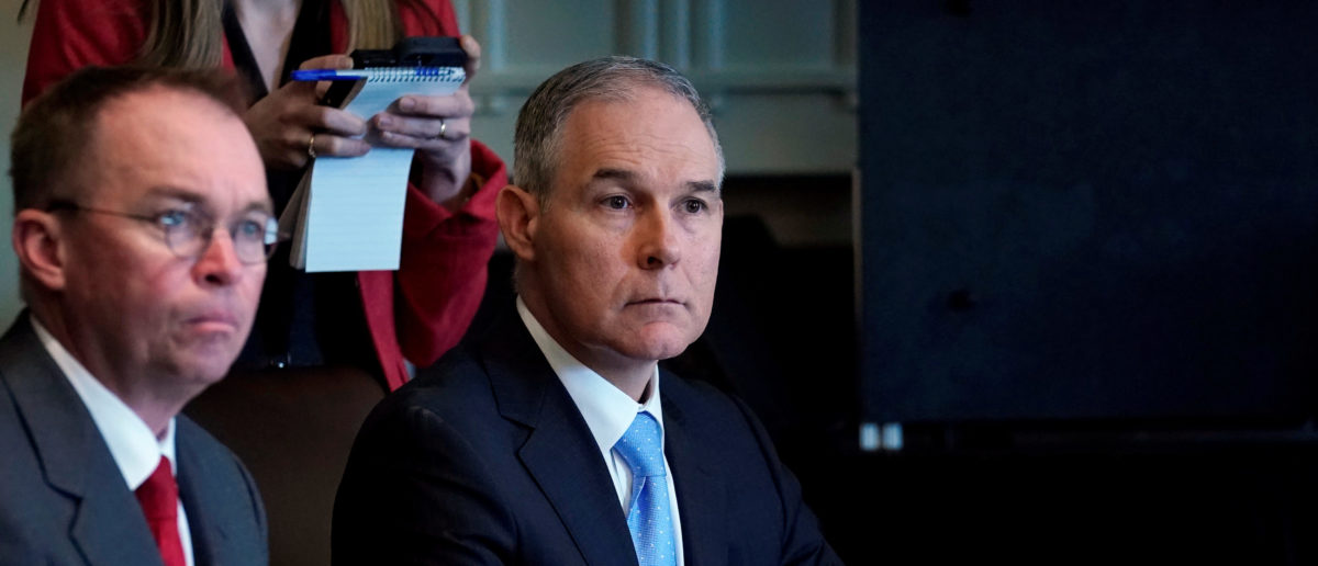 U.S. Environmental Protection Agency administrator Scott Pruitt listens as U.S. President Donald Trump holds a cabinet meeting at the White House in Washington, U.S., April 9, 2018. REUTERS/Kevin Lamarque - RC117F98B9E0