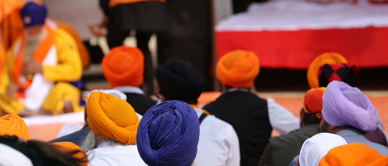 A group of Sikh men attend a religious ceremony (Shutterstock/ ChiccoDodiFC)