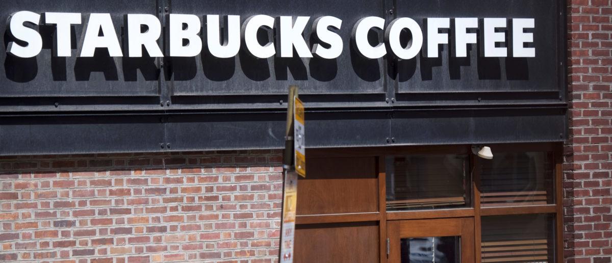 Women peer inside the closed Center City Starbucks, where two black men were arrested, in Philadelphia, Pennsylvania U.S. April 16, 2018. REUTERS/Mark Makela | Starbucks ADL Partnership Sparks Backlas