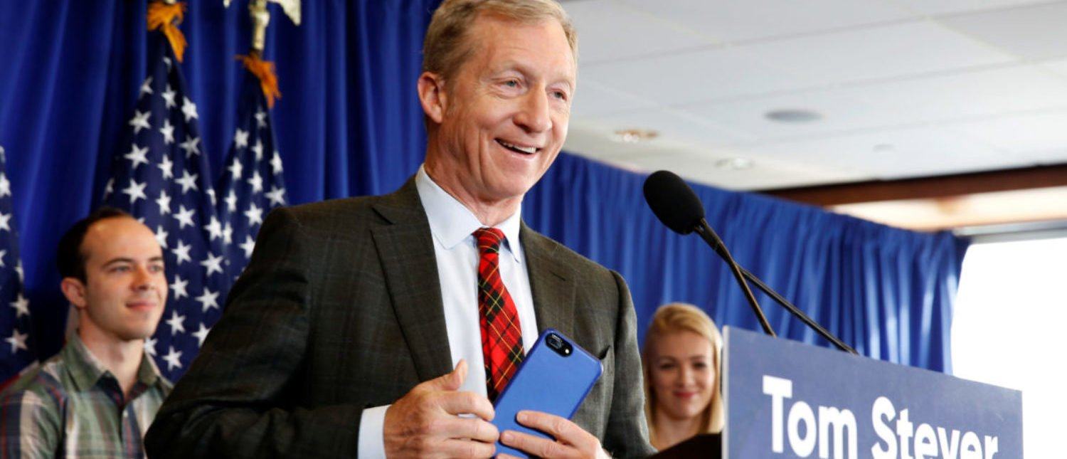 Tom Steyer, a hedge fund manager and a prominent Democratic fundraiser who has mounted a high-profile advertising campaign advocating the impeachment of U.S. President Donald Trump, holds a news conference to announce plans for his political future, in Washington, U.S., January 8, 2018. REUTERS/Joshua Roberts | Trump Burrows Deeper Into Steyers Head