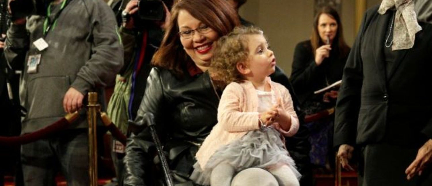 Senator Tammy Duckworth (D-IL) carries her daughter Abigail during a mock swearing in with U.S. Vice President Joe Biden during the opening day of the 115th Congress on Capitol Hill in Washington, U.S., January 3, 2017. REUTERS/Joshua Roberts