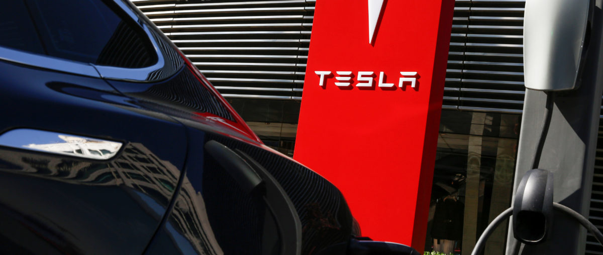 FILE PHOTO: A Tesla car charges at a charging station in Beijing, China, April 18, 2017.  REUTERS/Thomas Peter/File