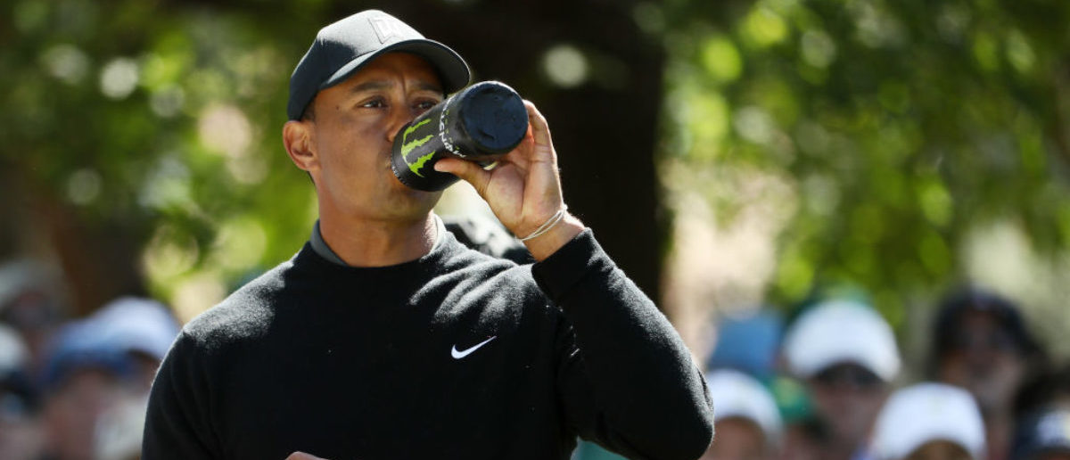 AUGUSTA, GA - APRIL 05: Tiger Woods of the United States drinks a beverage on the fourth tee during the first round of the 2018 Masters Tournament at Augusta National Golf Club on April 5, 2018 in Augusta, Georgia. (Photo by Jamie Squire/Getty Images)