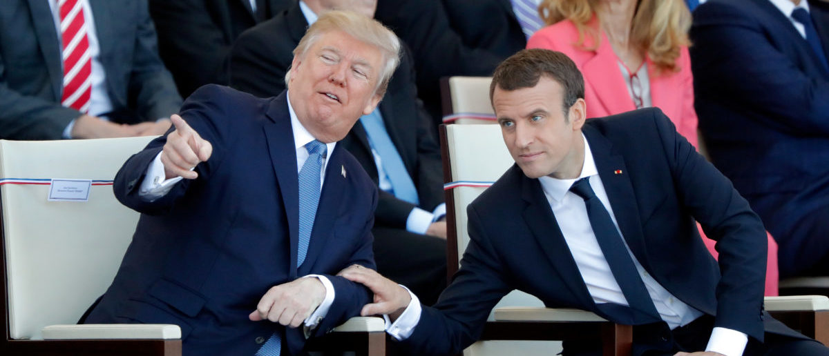 French President Emmanuel Macron and U.S. President Donald Trump attend the traditional Bastille Day military parade on the Champs-Elysees in Paris, France, July 14, 2017. REUTERS/Charles Platiau