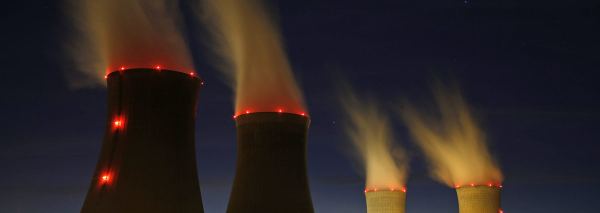 Steam rises at night from the cooling towers of the Electricite de France (EDF) nuclear power station in Dampierre-en-Burly, March 8, 2015. The future of France's nuclear industry has never looked bleaker, with a government pledging to wean the country off atomic power, cut-throat rivalry in world export markets and the debt of flagship nuclear group Areva mired deep in junk territory. Picture taken March 8, 2015. REUTERS/Christian Hartmann | Nuclear Energy A Big Deal For Trump