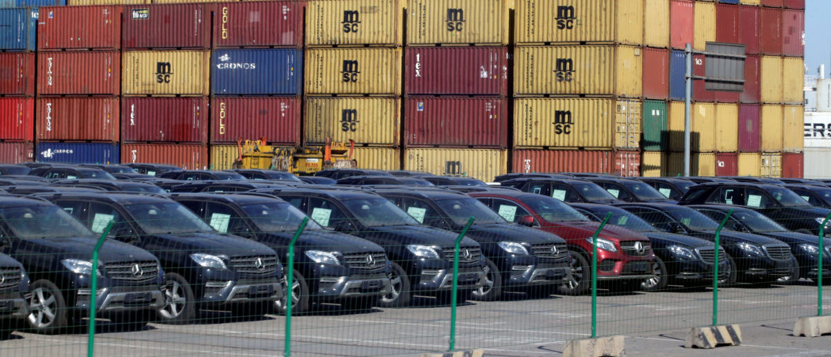 Imported Mercedes Benz cars are seen next to containers at Tianjin Port, in northern China February 23, 2017. REUTERS/Jason Lee
