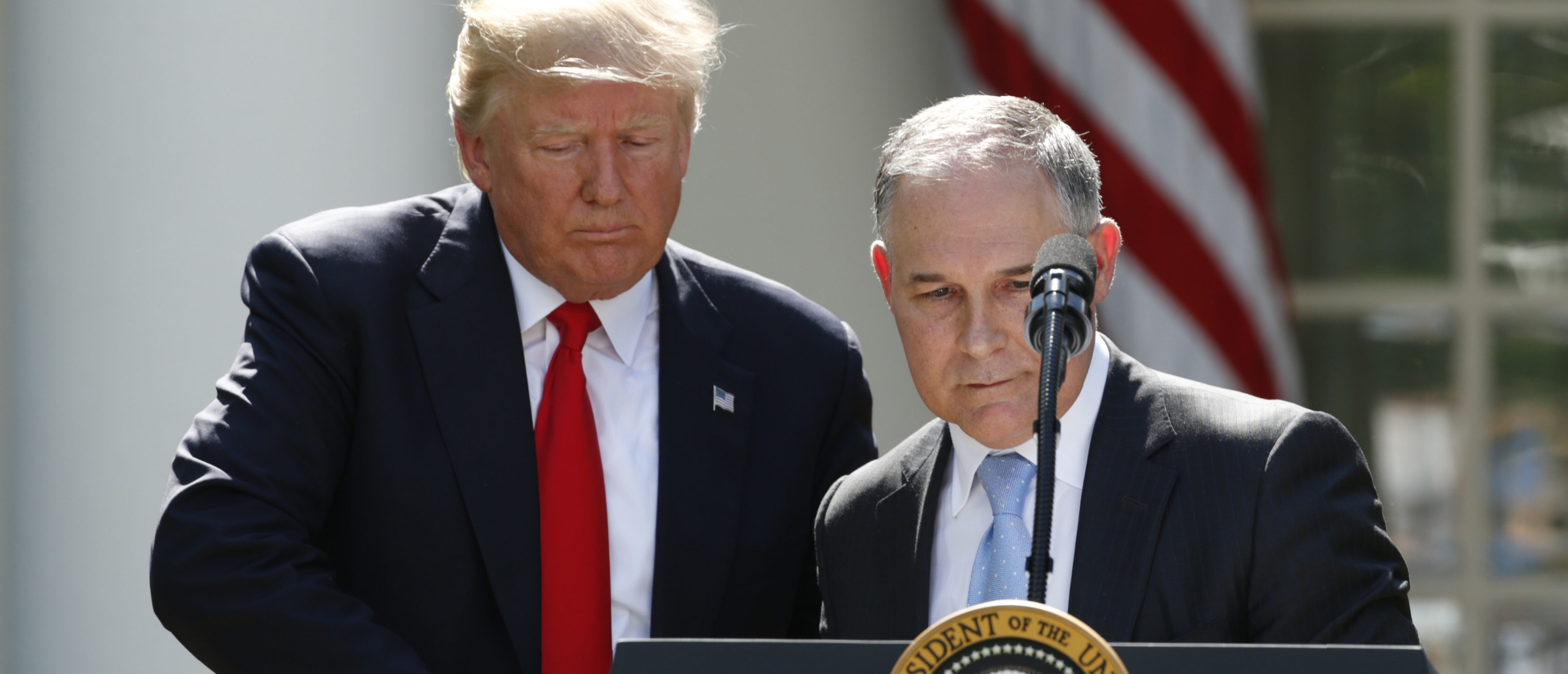 U.S. President Trump greets EPA Administrator Pruitt after announcing decision to withdraw from Paris Climate Agreement in the White House Rose Garden in Washington