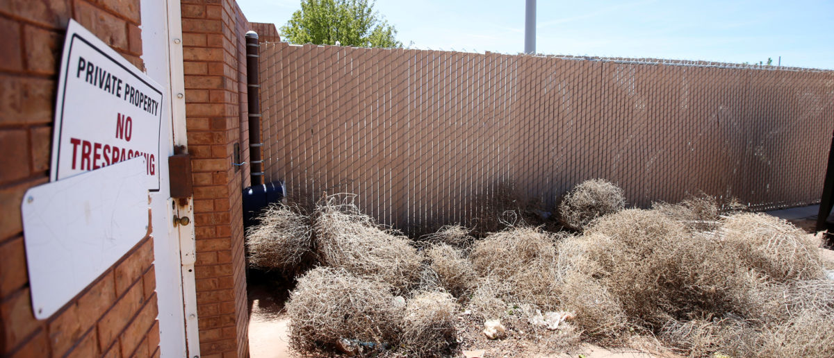Tumbleweeds and a no trespassing sign are seen outside the northwest entrance of FLDS Church's Prophet leaders Warren Jeff's compound where he lived for several years in Hildale, Utah, U.S., May 3, 2017. Picture taken May 3, 2017. REUTERS/George Frey