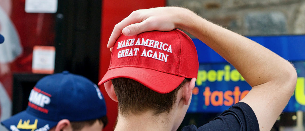Two unidentified men display their support for President Donald J. Trump through the hats they are wearing during a visit to the National Zoo - ShutterStock -- John M. Chase