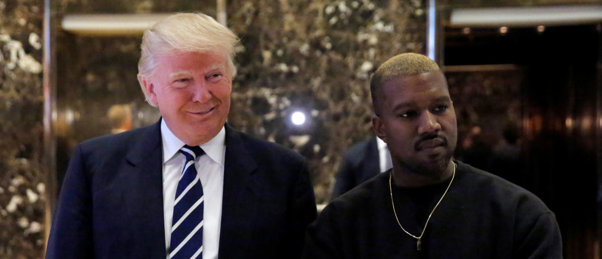 U.S. President-elect Donald Trump and musician Kanye West pose for media at Trump Tower in Manhattan, New York City, U.S., December 13, 2016. REUTERS/Andrew Kelly | Chicago Tribune Columnist Cries Racism