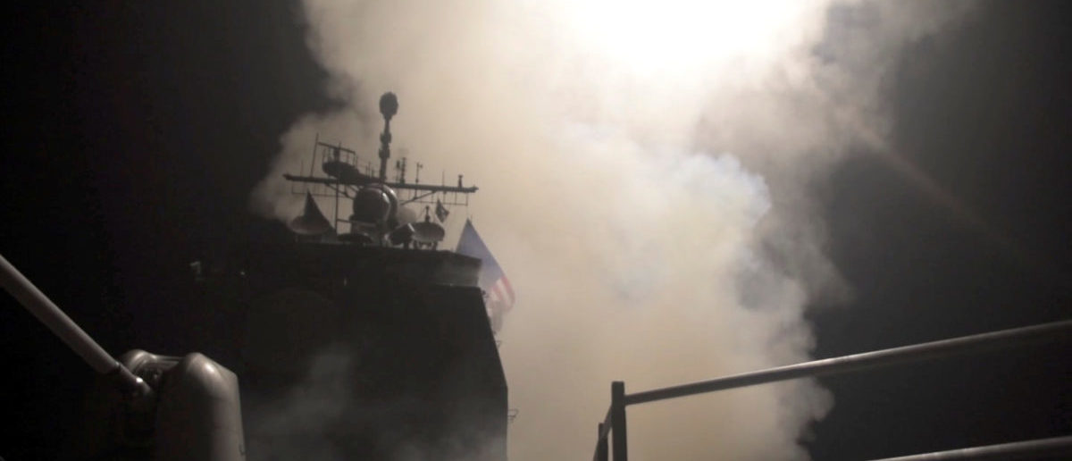 Smoke rises as the U.S. Navy guided-missile cruiser USS Monterey fires Tomahawk land attack missiles in this still image from Pentagon's video released on April 14, 2018. U.S. Navy Lt. j.g Matthew Daniels/Handout via REUTERS.