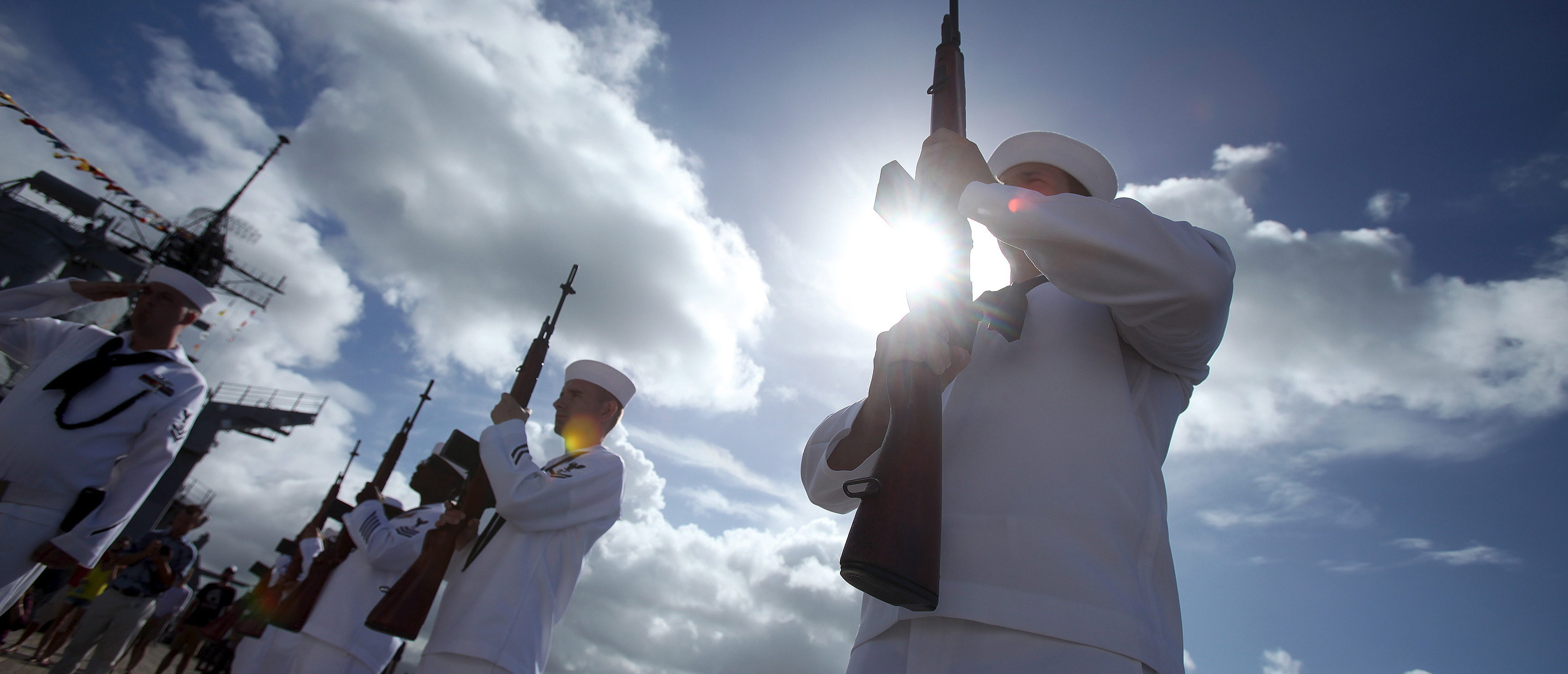 The U.S. Navy Rifle team stands at attention before the ceremony celebrating the 70th anniversary of  the end of World War II in the Pacific aboard the USS Battleship Missouri Memorial at Pearl Harbor in Honolulu, Hawaii, September 2, 2015. REUTERS/Hugh Gentry