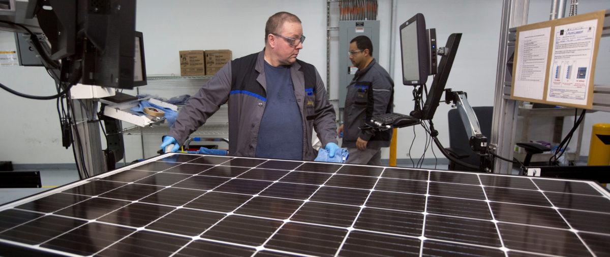 Production operator John White checks a panel at the SolarWorld solar panel factory in Hillsboro, Oregon, U.S., January 15, 2018. Picture taken January 15, 2018. REUTERS/Natalie Behring