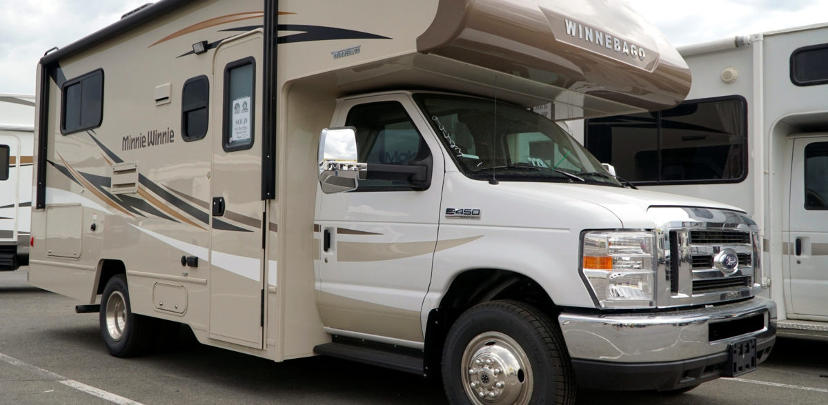 A pair of Winnebago motorhomes are ready for sale at a dealer in Golden