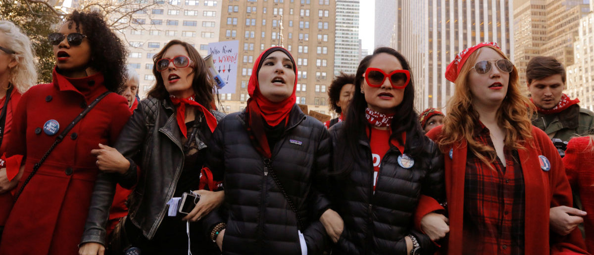Organizers Linda Sarsour (C), Carmen Perez (2nd R) and Bob Bland (R) lead during a 'Day Without a Woman' march on International Women's Day in New York, U.S., March 8, 2017. REUTERS/Lucas Jackson | Backpage.com Admits To Human Trafficking