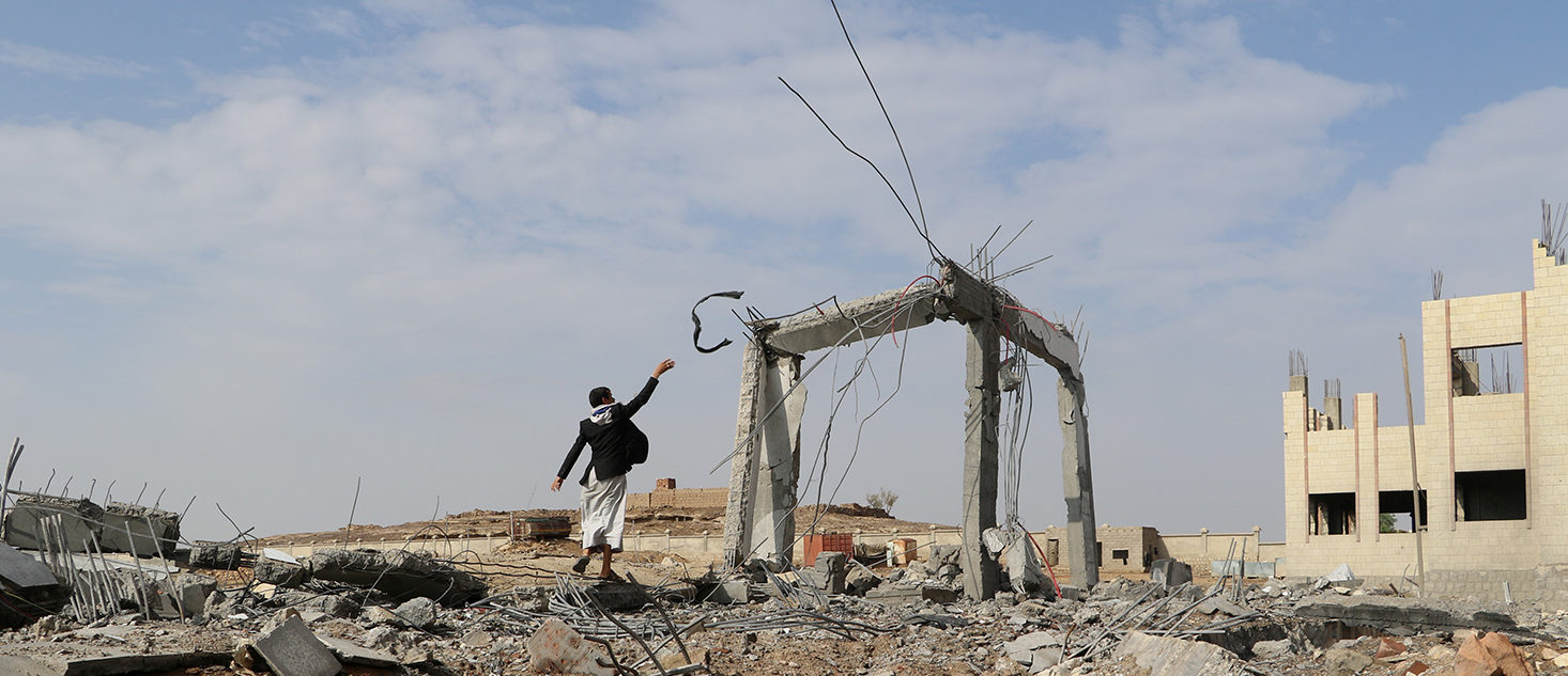 A man is seen at the site of an airstrike that destroyed the Community College in Saada, Yemen April 12, 2018. REUTERS/Naif Rahma