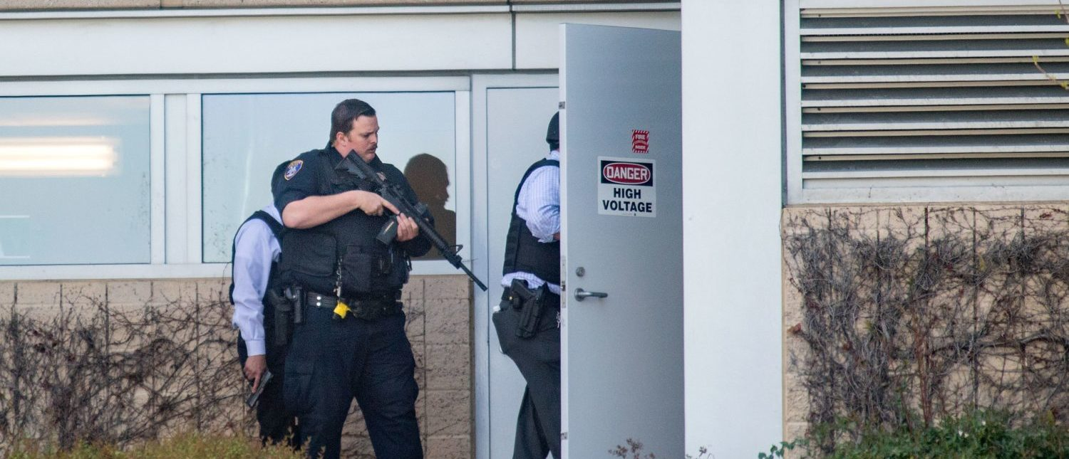 "Police search a building at YouTube's corporate headquarters as an active shooter situation was underway in San Bruno, California on April 03, 2018. Gunshots erupted at YouTube's offices in California Tuesday, sparking a panicked escape by employees and a massive police response, before the shooter -- a woman -- apparently committed suicide.Police said three people had been hospitalized with gunshot injuries following the shooting in the city of San Bruno, and that a female suspect was found dead at the scene. ""We have one subject who is deceased inside the building with a self-inflicted wound,"" San Bruno Police Chief Ed Barberini told reporters. ""At this time, we believe it to be the shooter."" (Photo: JOSH EDELSON/AFP/Getty Images)"
