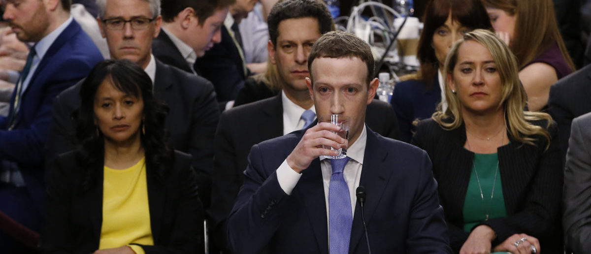Facebook CEO Mark Zuckerberg takes a drink while testifying before a Senate Judiciary and Commerce Committees joint hearing regarding the company's use and protection of user data on Capitol Hill in Washington, U.S., April 10, 2018. REUTERS/Alex Brandon/Pool