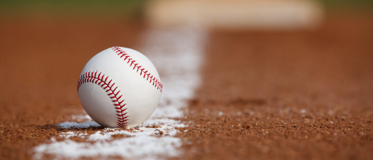 Baseball on the Infield Chalk Line with the Base in the distance (SHUTTERSTOCK: David Lee)