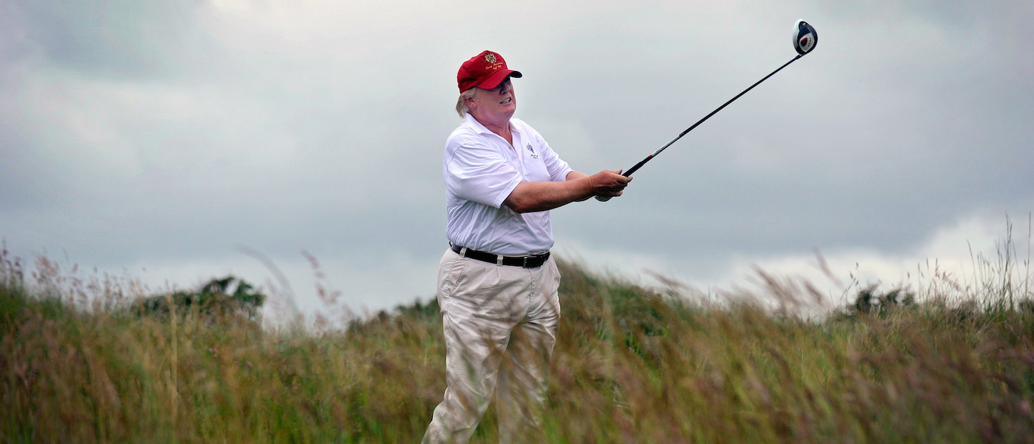U.S. tycoon Donald Trump plays a stroke as he officially opens his new multi-million pound Trump International Golf Links course in Aberdeenshire, Scotland, on July 10, 2012. Work on the course began in July 2010, four years after the plans were originally submitted. (Photo: Andy Buchanan/AFP/GettyImages)