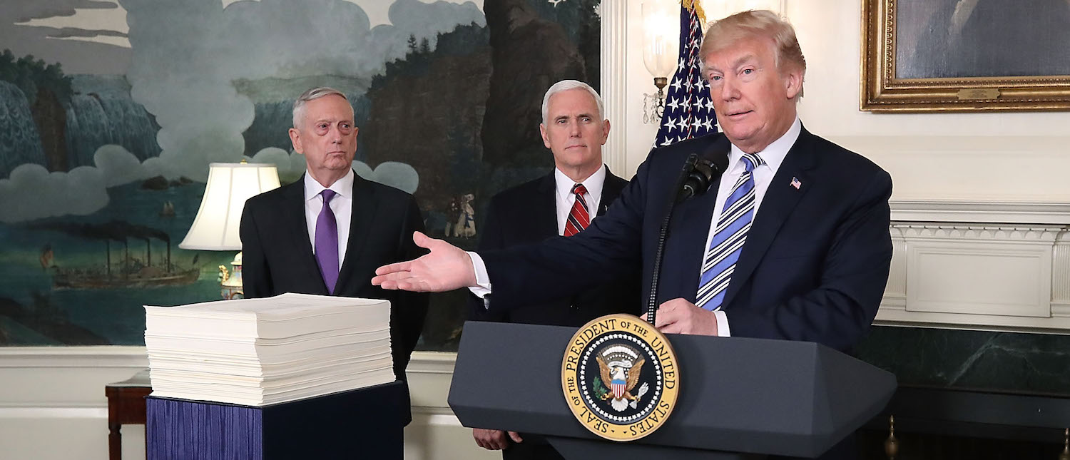 U.S. President Donald Trump speaks to the press about the $1.3 trillion spending bill passed by Congress early Friday,(Photo: Mark Wilson/Getty Images)