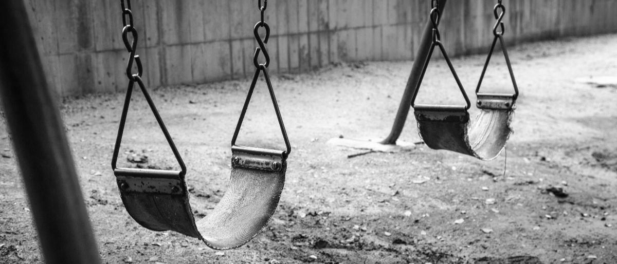 empty swings Shutterstock/Yukontorn