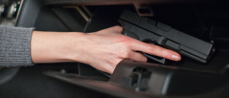 handgun in a glove compartment (Shutterstock/VasiliyBudarin)