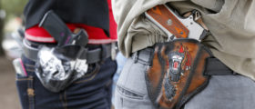 AUSTIN, TX - JANUARY 1: Art and Diana Ramirez of Austin with their pistols in custom-made holsters during and open carry rally at the Texas State Capitol on January 1, 2016 in Austin, Texas. On January 1, 2016, the open carry law takes effect in Texas, and 2nd Amendment activists hold an open carry rally. (Photo by Erich Schlegel/Getty Images)