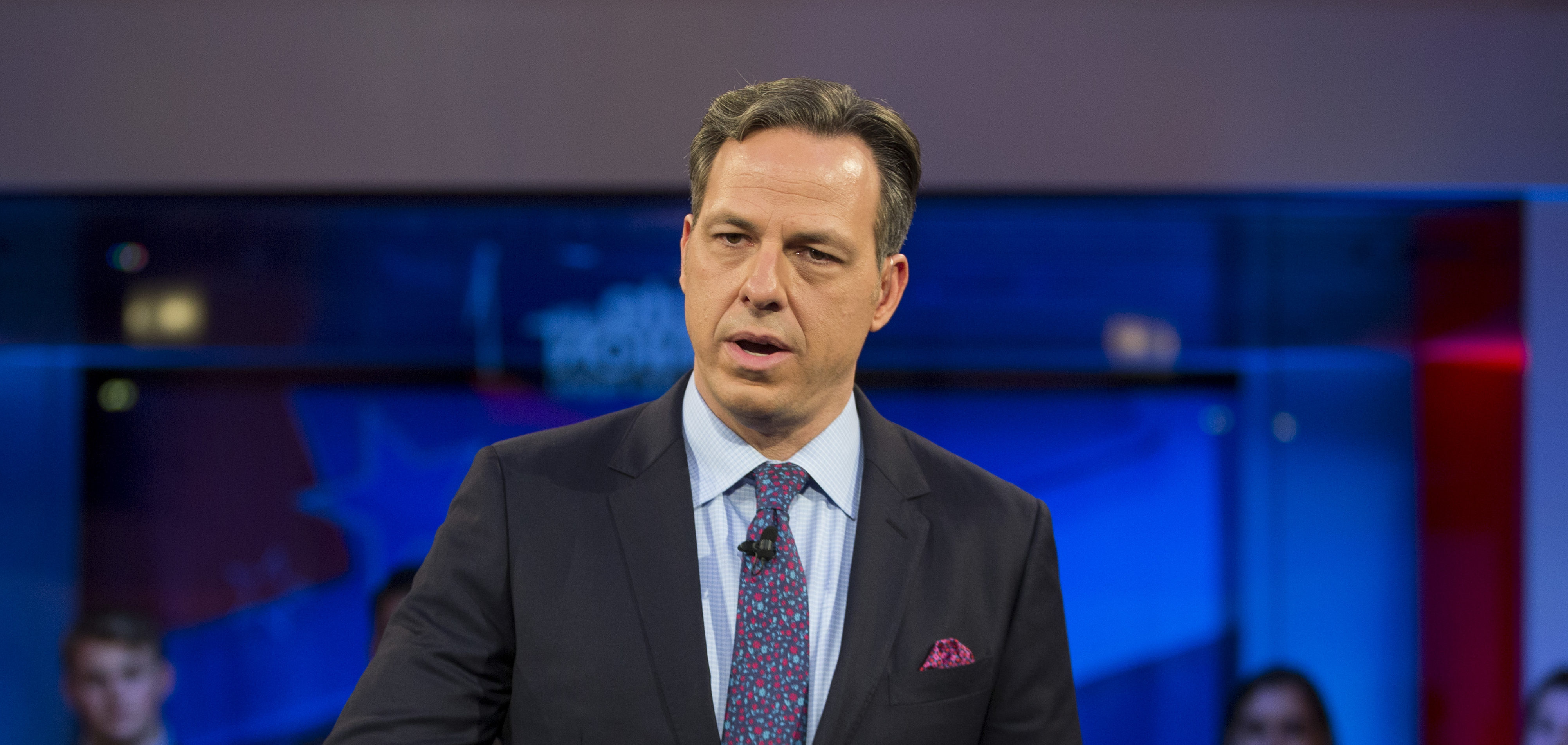 """CAMBRIDGE, MA - DECEMBER 01: Jake Tapper, of CNN's State of the Union, speaks to a crowd at the Harvard Institute of Politics Forum before Trump Campaign Manager Kellyanne Conway and Clinton Campaign Manager Robby Mook enter the room for an event titled """"War Stories: Inside Campaign 2016"""" on December 1, 2016 in Cambridge, Massachusetts. (Photo by Scott Eisen/Getty Images)"""
