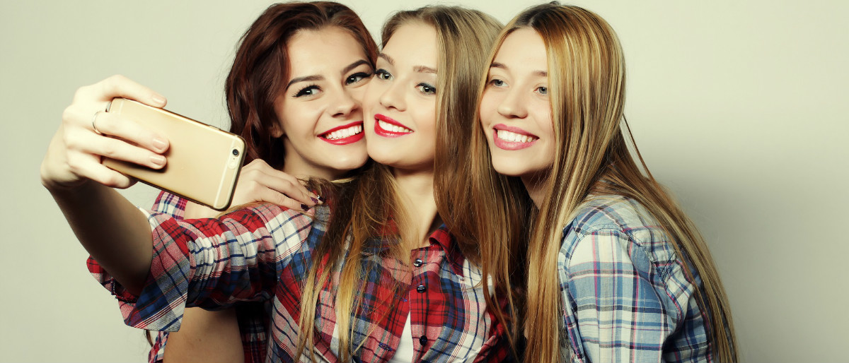 millennials selfie Shutterstock/Raisa Kanareva