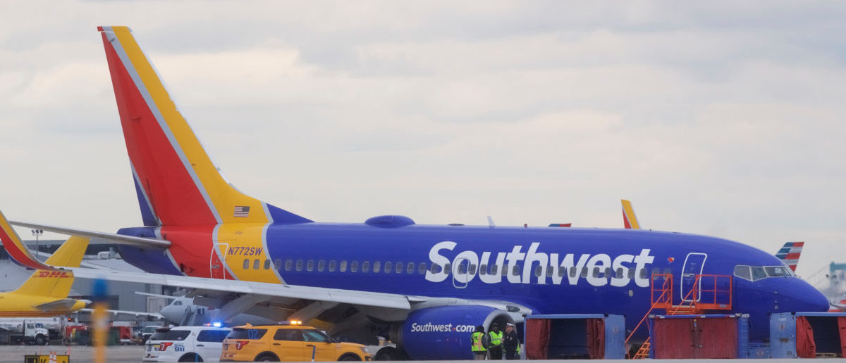 Emergency personnel monitor the damaged engine of Southwest Airlines Flight 1380, which diverted to the Philadelphia International Airport this morning after the airline crew reported damage to one of the aircraft's engines, on a runway in Philadelphia, Pennsylvania U.S. April 17, 2018. REUTERS/Mark Makela