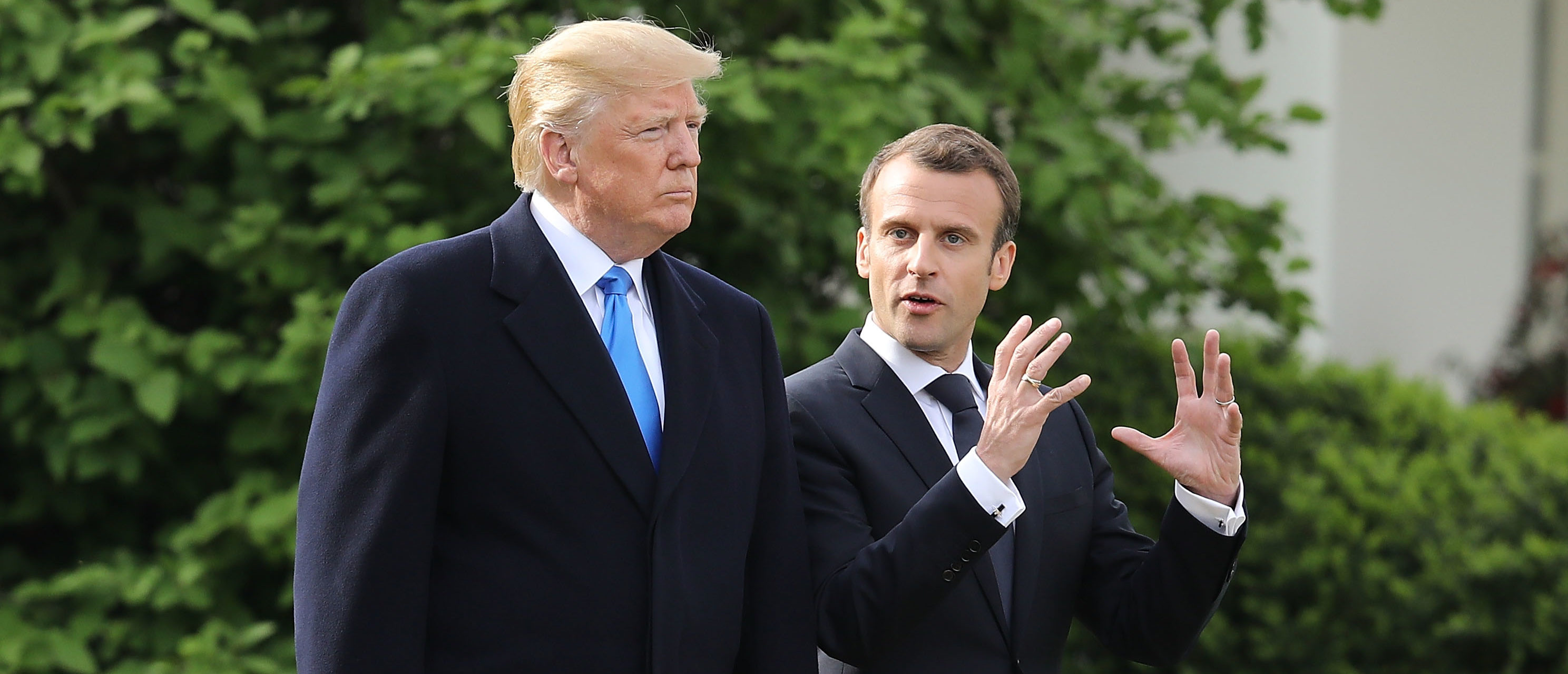 WASHINGTON, DC - APRIL 23: U.S President Donald Trump (L) and French President Emmanuel Macron walk out of the White House before participating in a tree-planting ceremony on the South Lawn April 23, 2018 in Washington, DC. Trump is hosting Macron for a two day offical visit that will include dinner at George Washington's Mount Vernon, a tree planting on the White House South Lawn and a joint news conference. (Photo by Chip Somodevilla/Getty Images)