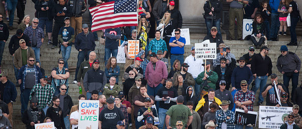 """OLYMPIA, WA - APRIL 21: A crowd of second amendment supporters protest during a """"March For Our Rights"""" pro-gun rally at the Washington State Capitol on April 21, 2018 in Olympia, Washington. (Photo by Matt Mills McKnight/Getty Images)"""