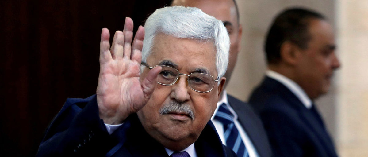 Palestinian President Mahmoud Abbas waves in Ramallah, in the occupied West Bank May 1, 2018. REUTERS/Mohamad Torokman/File Photo | Palestinian Leader Abbas Hospitalized