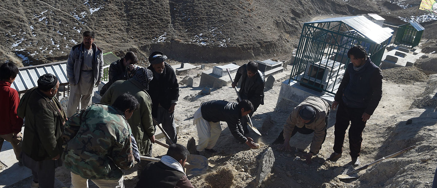 Afghan Shiite mourners cover the grave with soil during funeral prayers for one of the 41 victims of a bomb attack on a Shiite cultural center in Kabul on December 29, 2017.7. Mourners wept December 29 as they buried loved ones killed in a suicide attack on Shiites in Kabul, the latest victims in one of the bloodiest years for civilians on record in the war-torn country. Multiple blasts at a pro-Iran Shiite cultural centre in the Afghan capital on Thursday left more than 40 people dead and dozens more wounded in the brutal attack claimed by the Islamic State group. Getty Images/ WAKIL KOHSAR