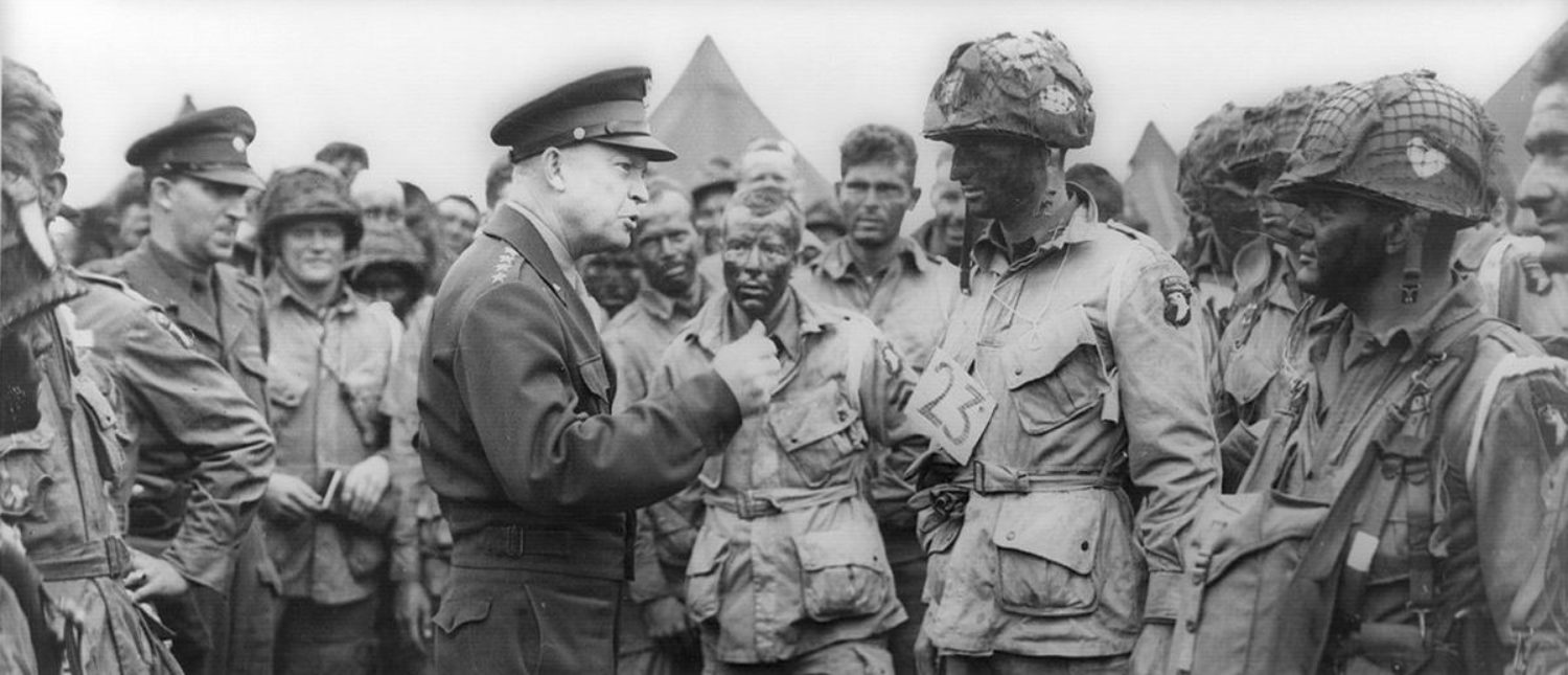 Allied forces Supreme Commander General Dwight D. Eisenhower speaks with U.S. Army paratroopers of Easy Company, 502nd Parachute Infantry Regiment (Strike) of the 101st Airborne Division, at Greenham Common Airfield in England June 5, 1944 in this handout photo provided by the US National Archives. On June 6, 1944, allied soldiers descended on the beaches of Normandy for D-Day - an operation that turned the tide of the Second World War against the Nazis, marking the beginning of the end of the conflict. Today, as many around the world prepare to commemorate the 70th anniversary of the landings, pictures of Normandy's now-touristy beaches stand in stark contrast to images taken around the time of the invasion. But while the landscape has changed, the memory of the momentous event lives on. Reuters photographer Chris Helgren compiled a series of archive pictures taken during the 1944 invasion and then went back to the same places, to photograph them as they appear today. Picture taken June 5, 1944. REUTERS/US National Archives/Handout via Reuters