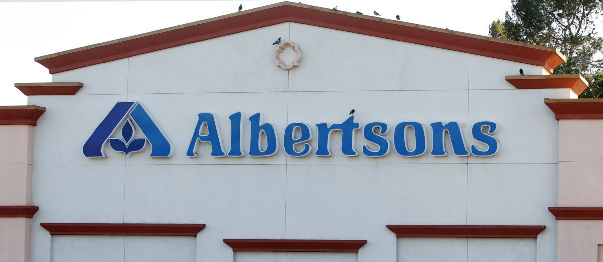 Birds perch upon signage for an Albertsons grocery store in Burbank, California July 17, 2012. Albertsons is owned by Supervalu, the third-largest U.S. grocery chain with other brands such as Jewel-Osco and Save-A-Lot. C&S Wholesale Grocers would be interested in buying the distribution business of grocer Supervalu Inc, which last week said it was exploring a sale of all or part of the company, the Wall Street Journal reported on Monday citing people familiar with the matter. REUTERS/Fred Prouser (UNITED STATES)   Grocery Store Harassed Hispanic Workers