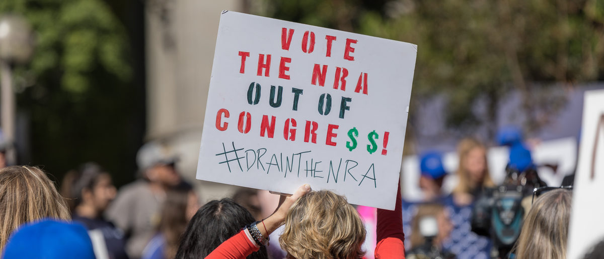 """""""Vote the NRA out of Congress!"""" sign held by a protester at the People's Rally Against Gun Violence in Los Angeles, Calif., Feb. 19, 2018. (Shutterstock/Karl_Sonnenberg) 