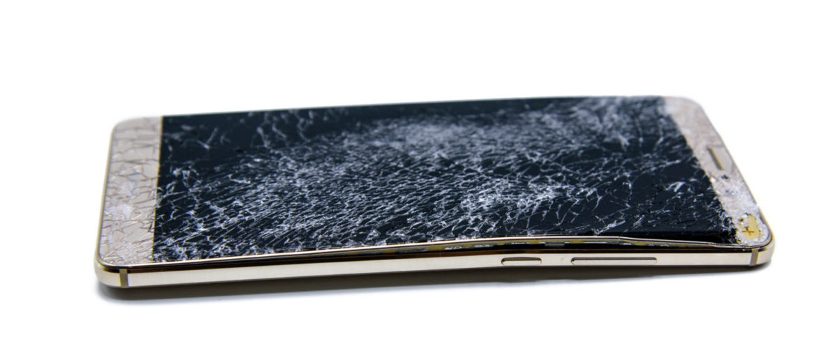 A cracked mobile device with a bend. [Shutterstock - bump23] | Motherboard: Apple Knew iPhone 6 Bended